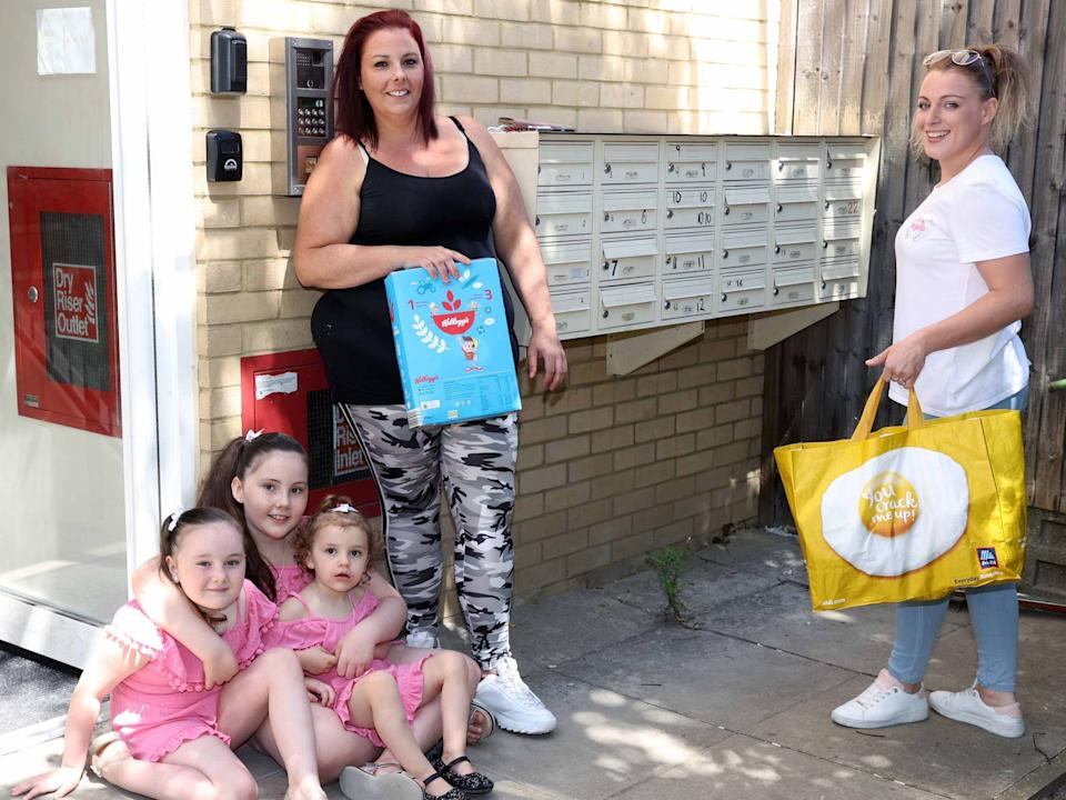 High Barnet family given food parcel by volunteer Katie-Louise Barber (right)Nigel Howard