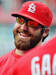 Jason Motte talks with teammates during batting practice before a September game in Philadelphia. He wears prescription eyewear off the mound