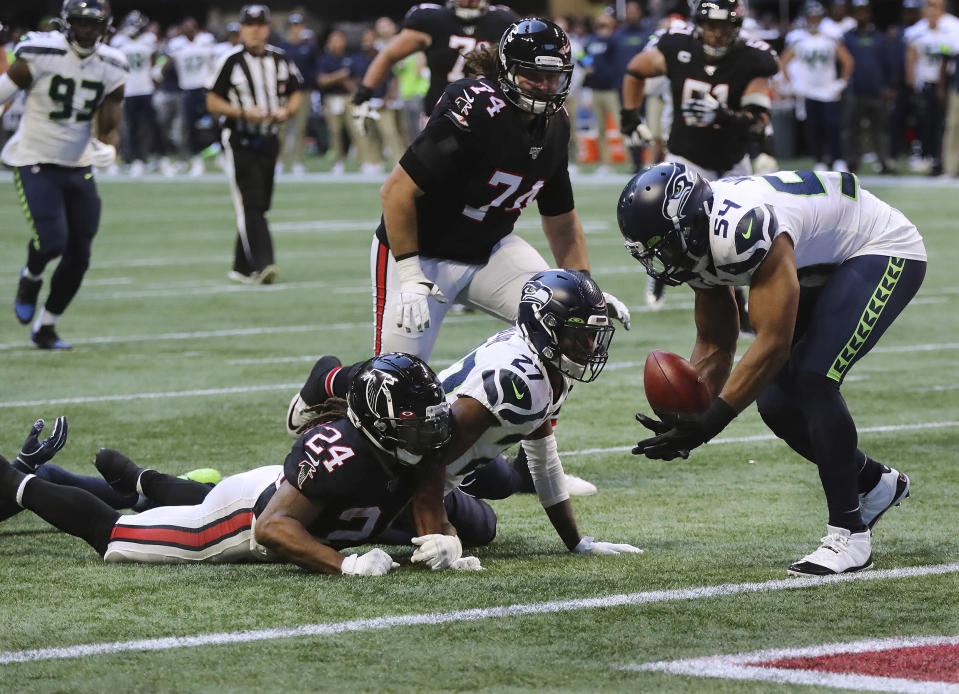 Atlanta Falcons running back Devonta Freeman (24) fumbles at the Seattle Seahawks one-yard line with Seahawks linebacker Bobby Wagner recovering the ball during the fourth quarter of an NFL football game on Sunday, Oct. 27, 2019, in Atlanta. (Curtis Compton/Atlanta Journal-Constitution via AP)