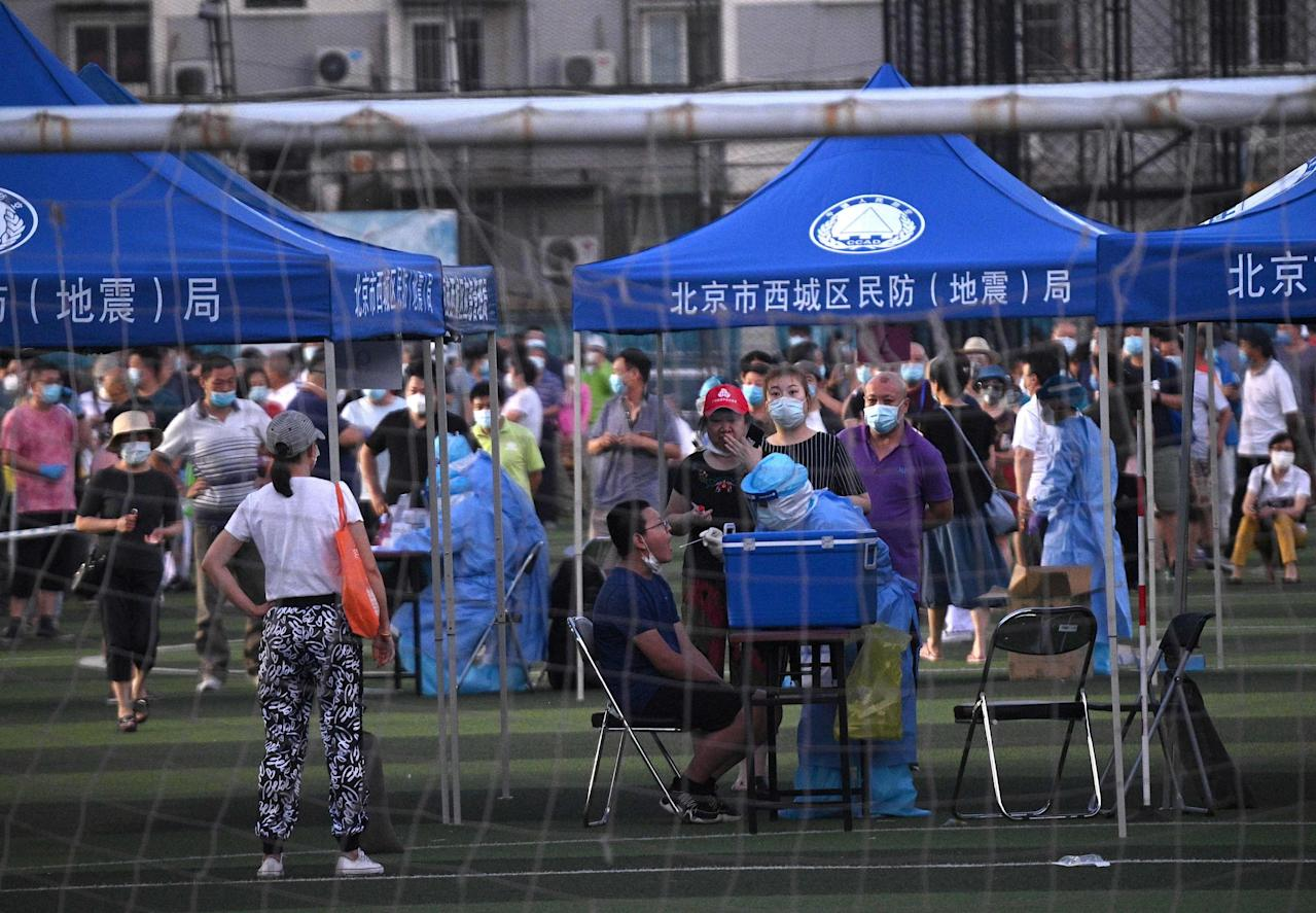 China reviews highest coronavirus case rise for 2 months, as lockdowns ease globally