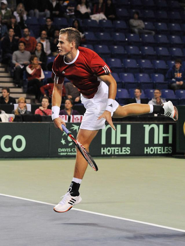 Vasek Pospisil of Canada serves to Jo-Wilfried Tsonga of France during the Davis Cup tennis action on February 10, 2012 at the Doug Mitchell Thunderbird Sports Centre, University of British Columbia, Vancouver, British Colombia, Canada. AFP PHOTO / Don MACKINNON (Photo credit should read Don MacKinnon/AFP/Getty Images)