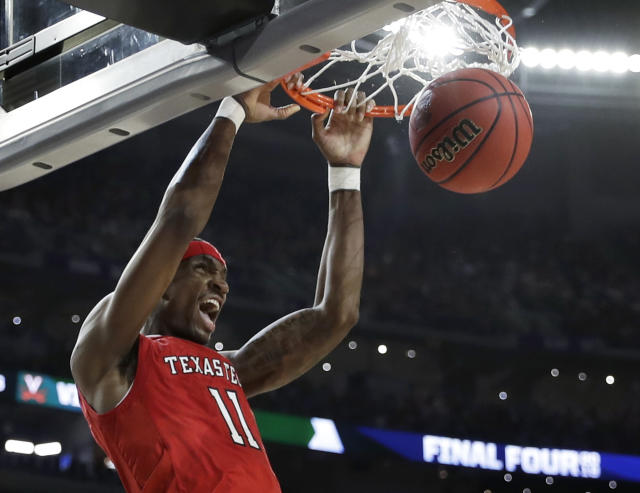 Texas Tech forward Tariq Owens dunks the ball during the first half against Virginia in the championship game of the Final Four NCAA college basketball tournament, Monday, April 8, 2019, in Minneapolis. (AP Photo/David J. Phillip)