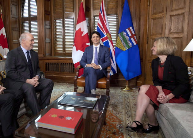Prime Minister Justin Trudeau, B.C. Premier John Horgan, left, and Alberta Premier Rachel Notley, sit in Trudeau's office on Parliament Hill for a meeting on the deadlock over Kinder Morgan's Trans Mountain pipeline expansion, in Ottawa on April 15, 2018.