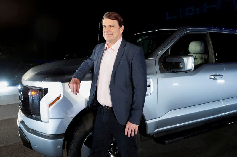 FILE PHOTO: Ford CEO Jim Farley poses with the Ford F-150 Lightning pickup truck
