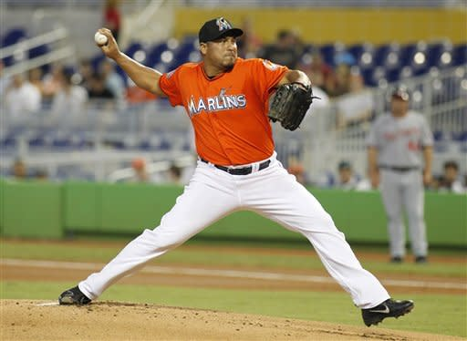 Miami Marlins' Carlos Zambrano (38) throws the ball against the Washington Nationals in the first inning during a baseball game at Marlins Park in Miami, on Monday, May 28, 2012. (AP Photo/Joel Auerbach)