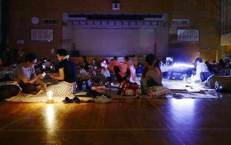 FILE PHOTO: Evacuees are seen at a gymnasium of elementary school, acting as an evacuation shelter, during blackout after an earthquake hit the area in Sapporo