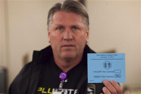 A union member displays his vote against the proposed contract during a union vote at the International Association of Machinists District 751 Headquarters in Seattle, Washington by members of the International Association of Machinists on a proposed contract by the Boeing Company to build the 777X jetliner November 13, 2013. REUTERS/David Ryder
