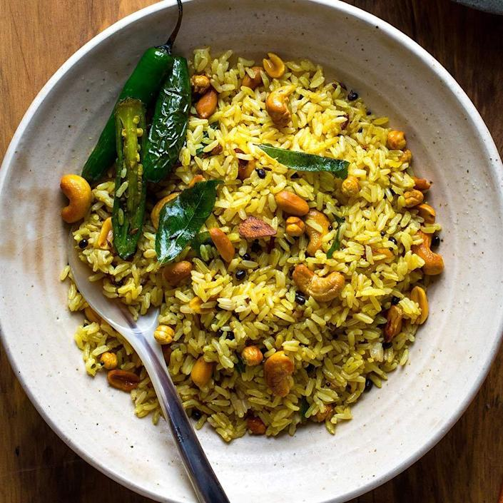 <p>Use up leftover rice and make it into something delicious with this healthy Indian recipe. Because cooked rice refrigerated overnight dries out a little, it's better suited to absorb all the flavors in this dish without getting sticky or mushy. In a pinch, use frozen or shelf-stable precooked basmati rice, available in many stores. Urad dal and roasted chana dal add texture and authenticity to the rice--look for both types of dal in Indian markets or online.</p>