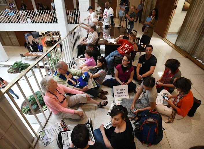 <p>Protesters to House Bill 2 hold a sit-in on the second floor of the Legislative Building after a rally in Raleigh, N.C., on April 25, 2016. <i>(Chuck Liddy/The News & Observer via AP)</i></p>
