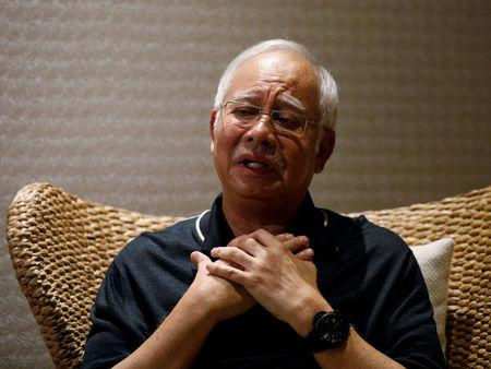 FILE PHOTO: Malaysia's former prime minister Najib Razak speaks to Reuters during an interview in Langkawi, Malaysia