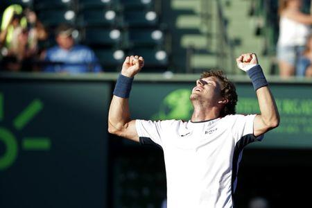 Mar 29, 2018; Key Biscayne, FL, USA; Pablo Carreno Busta of Spain celebrates after his match against Kevin Anderson of South Africa (not pictured) on day ten of the Miami Open at Tennis Center at Crandon Park.  Mandatory Credit: Geoff Burke-USA TODAY Sports