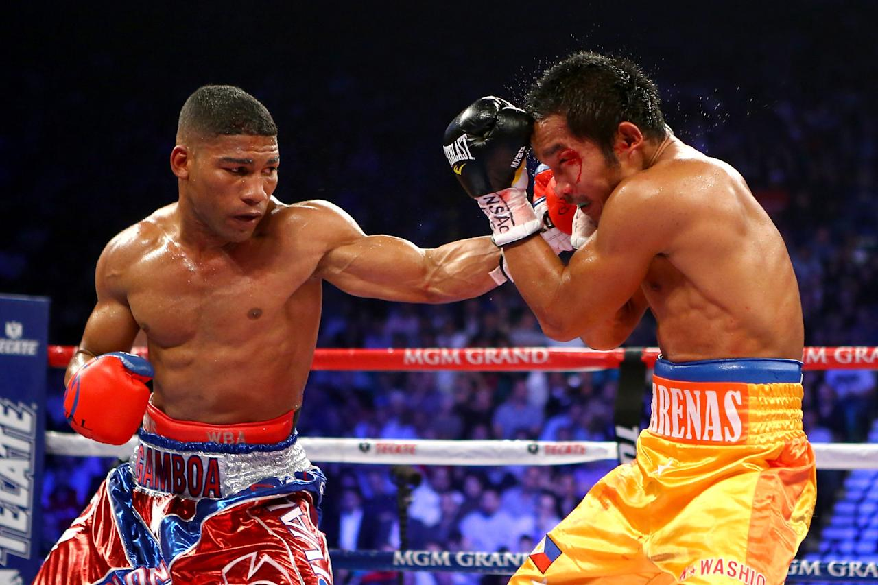LAS VEGAS, NV - DECEMBER 08:  (L-R) Yuriorkis Gamboa connects with a left to the head of Michael Farenas during their super featherweight bout at the MGM Grand Garden Arena on December 8, 2012 in Las Vegas, Nevada.  (Photo by Al Bello/Getty Images)