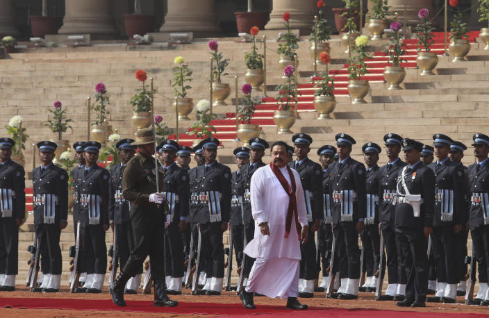 Sri Lankan Prime Minister Mahinda Rajapaksa inspects a joint military guard of honor during his ceremonial reception at the Indian presidential palace, in New Delhi, India, Saturday, Feb. 8, 2020. Rajapaksa is on a four day state visit to India. (AP Photo/Manish Swarup)