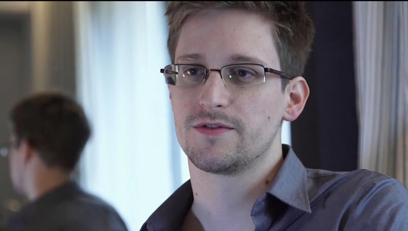 This photo provided by The Guardian Newspaper in London shows Edward Snowden, who worked as a contract employee at the National Security Agency, on Sunday, June 9, 2013, in Hong Kong. In geopolitics just as on the local playground, even best friends don't tell each other everything. And everybody's dying to know what the other guy knows. Revelations that the U.S. was monitoring the cellphone calls of up to 35 world leaders, including close allies, have brought into high relief the open-yet-often-unspoken secret _ and suggested the incredible reach of new-millennium technology. (AP Photo/The Guardian, Glenn Greenwald and Laura Poitras)