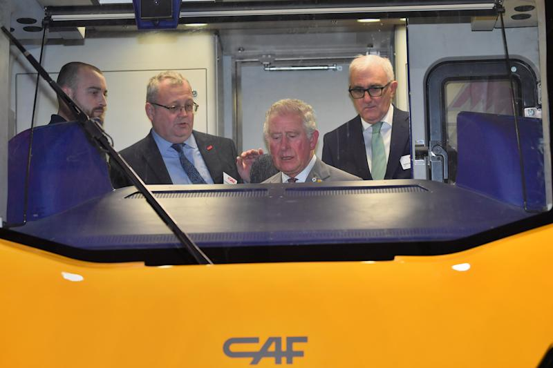 The Prince of Wales sitting in the drivers seat of a train being constructed during a visit to the CAF train factory in Newport, Wales.
