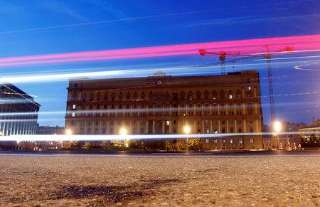 Cars drive near headquarters of the Federal Security Service in Moscow
