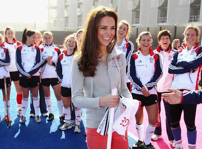 Britain's Duchess of Cambridge smiles as she meets the British Olympic hockey teams at the Riverside Arena in the Olympic Park, London, Thursday March 15, 2012. The Duchess of Cambridge viewed the Olympic Park and met members of the men's and women's British hockey teams. (AP Photo/Chris Jackson, Pool)