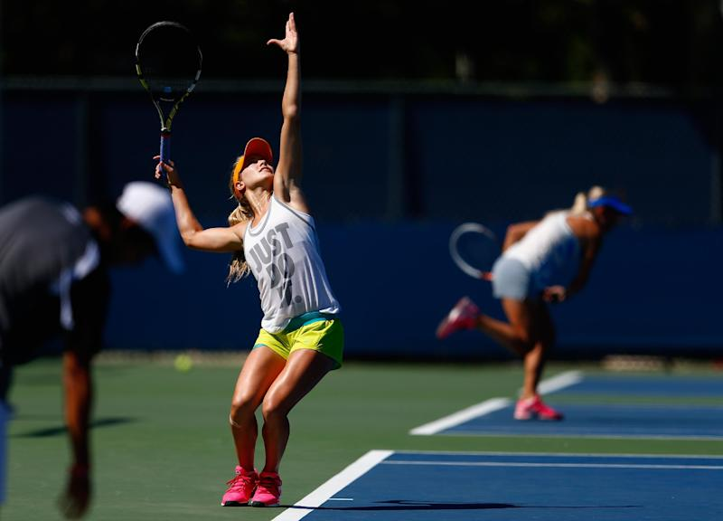 Eugenie Bouchard of Canada practices her serve during previews for the US Open tennis at USTA Billie Jean King National Tennis Center on August 24, 2014