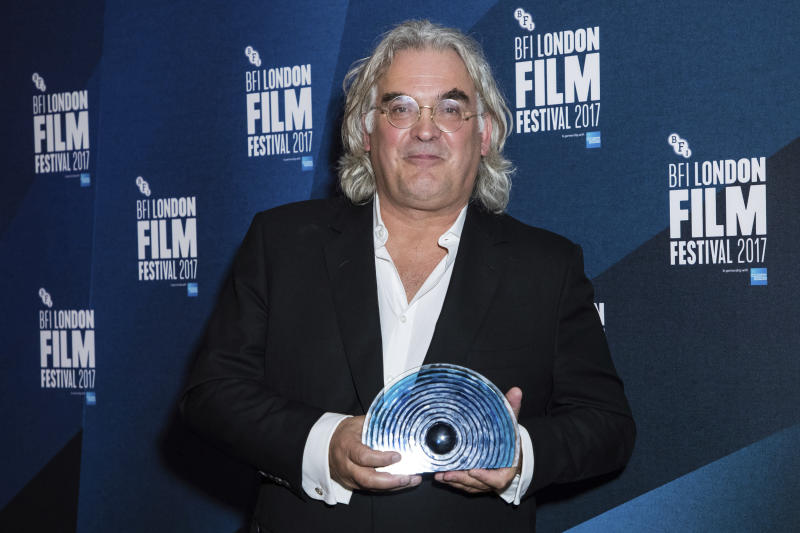Paul Greengrass poses for photographers after receiving the BFI Fellowship award at the London Film Festival Awards in 2017. (Photo by Vianney Le Caer/Invision/AP)
