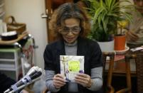 Junko Ishido, mother of Kenji Goto, who is a Japanese journalist being held captive by Islamic State militants, holds letters from her supporters as she speaks to reporters at her house in Tokyo January 28, 2015. REUTERS/Yuya Shino