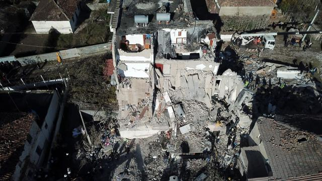 Rescuers search at a damaged building after a magnitude 6.4 earthquake in Thumane, western Albania, on Nov. 26. (Photo: Hektor Pustina/AP)