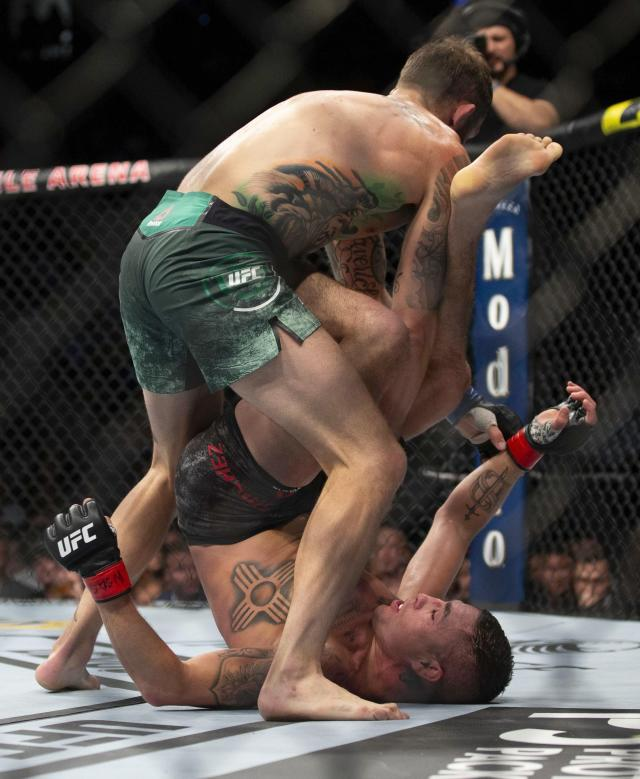 Diego Sanchez, bottom, defends himself against Michael Chiesa during their welterweight mixed martial arts bout at UFC 239, Saturday, July 6, 2019, in Las Vegas. Chiesa won by unanimous decision. (AP Photo/Eric Jamison)