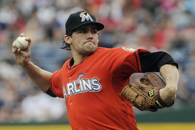 RETRANSMISSION TO CORRECT NAME - Miami Marlins' Nathan Eovaldi pitches against the Atlanta Braves during the first inning of a baseball game, Sunday, Sept. 1, 2013, in Atlanta. (AP Photo/John Amis)