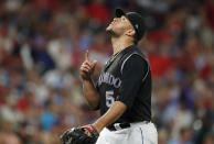 Colorado Rockies relief pitcher Carlos Estevez gestures after striking out St. Louis Cardinals pinch-hitter Jose Martinez with two runners on base to end the top of the seventh inning of a baseball game Tuesday, Sept. 10, 2019, in Denver. (AP Photo/David Zalubowski)
