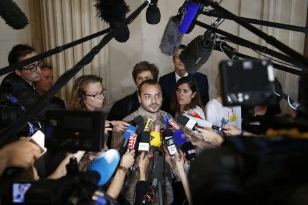 Francois Lambert, the nephew of Vincent Lambert, who is tetraplegic and currently on artificial life support, speaks to the media after the verdict in a judicial case at the Council of State in Paris