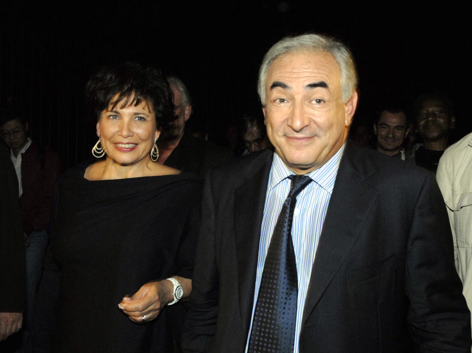 With three weeks remaining for Socialist candidates to pursuade the party to choose them as candidate for the 2007 presidential elections, Dominique Strauss-Khan campaigns in the 13th arrondissement of Paris, his wife, journalist Anne Sinclair, at his side. (Photo by Alain Nogues/Corbis via Getty Images)