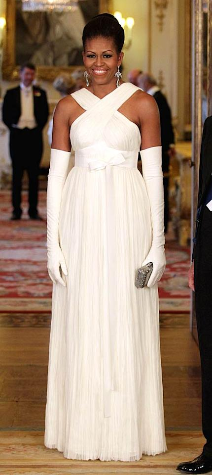 "I'm on the fence, so let me know what you think of the ivory Tom Ford gown and evening gloves First Lady Michelle Obama donned for the state banquet at Buckingham Palace. Too bridal or truly beautiful? Chris Jackson - WPA Pool/<a href=""http://www.gettyimages.com/"" target=""new"">GettyImages.com</a> - May 24, 2011"