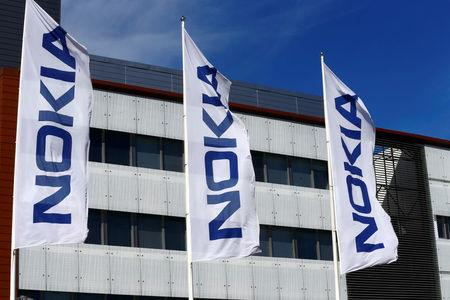 FILE PHOTO:Flags with the Nokia logo flutter at company's headquarters in Espoo