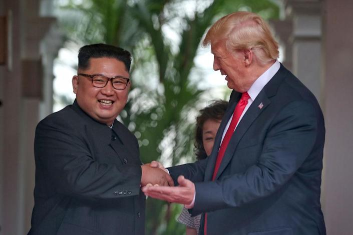 Kim Jong-un smiles as he greets Donald Trump (Picture: Getty)