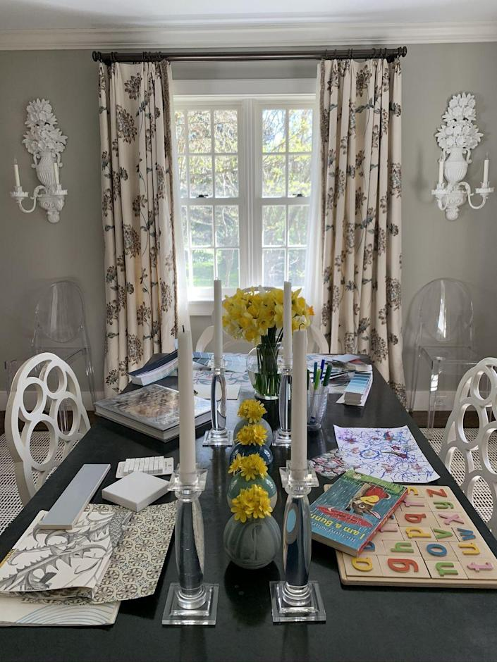 "<p>In a world where dining tables double as desks and us creatives need plenty of space to get inspired, some days, organization is all in the piles—so long as you can manage them.<br></p><p> ""The key to having 'a beautiful, organized desk' is maintenance. As a decorator, I need to spread out and have a lot of different things– fabrics, tear sheets, paint fans, finish samples, etc.—at the ready, so my desk is our dining room table. I have a very hard time getting rid of anything—even if it's not quite the right fit for what I am working on—so the table is a constant creative 'work in progress.' To keep myself (and those around me) from going nuts, I have to be disciplined about tidying at the end of every day. Since the table is a big, flat surface without any storage, I make little organized piles."" —Elizabeth Pyne Singer, <a href=""http://mcmilleninc.com/"" rel=""nofollow noopener"" target=""_blank"" data-ylk=""slk:McMillen Inc."" class=""link rapid-noclick-resp"">McMillen Inc.</a></p>"