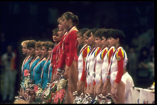 21 SEP 1988: THE GYMNASTICS TEAM OF THE SOVIET UNION (CENTRE) RECEIVE THEIR GOLD MEDALS AFTER WINNING THE TEAM COMBINED COMPETITION AS THEY ARE FLANKED BY ROMANIA (RIGHT) AND EAST GERMANY (LEFT) AT THE 1988 SEOUL OLYMPICS.