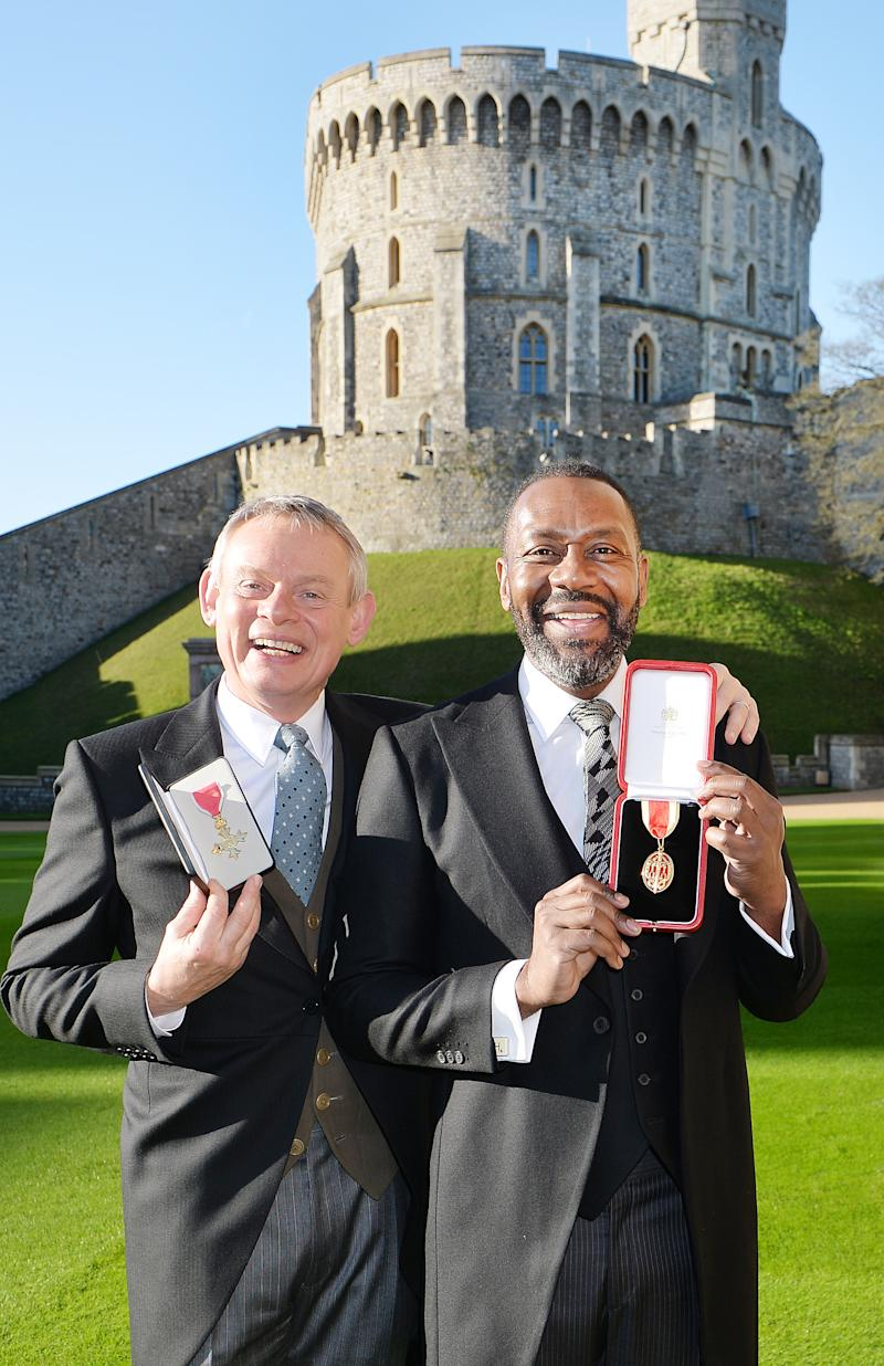 WINDSOR, UNITED KINGDOM - DECEMBER 4: Martin Clunes (left) after receiving an Officer of the Order of the British Empire (OBE) and Sir Lenny Henry who received a Knighthood from Queen Elizabeth II during an Investiture ceremony at Windsor Castle on December 4, 2015 in Windsor, England. (Photo by John Stillwell - WPA Pool/Getty Images)