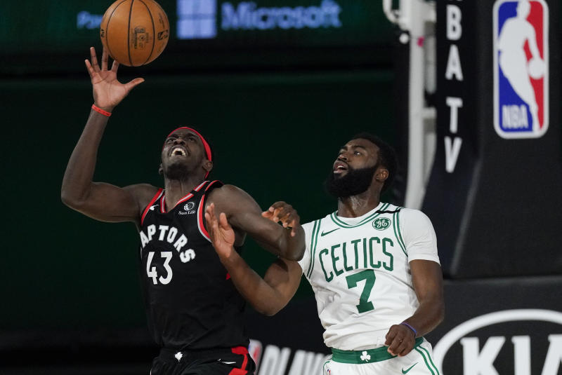 Toronto Raptors' Pascal Siakam (43) catches a pass in front of Boston Celtics' Jaylen Brown (7) during the second half of an NBA conference semifinal playoff basketball game Saturday, Sept. 5, 2020, in Lake Buena Vista, Fla. (AP Photo/Mark J. Terrill)