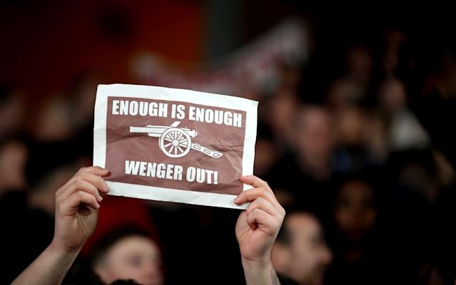 <span>One Arsenal fans displayed an A4 print off of 'Wenger Out'</span> <span>Credit: PA </span>