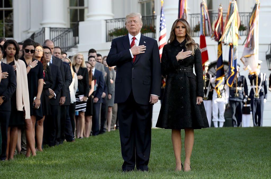 <div>Melania led a moment of silence with President Trump to commemorate the lives lost during the 2001 terrorist attacks. For the service, FLOTUS wore a black, belted jacquard coat with black heels to match - fitting for the somber occasion.</div>
