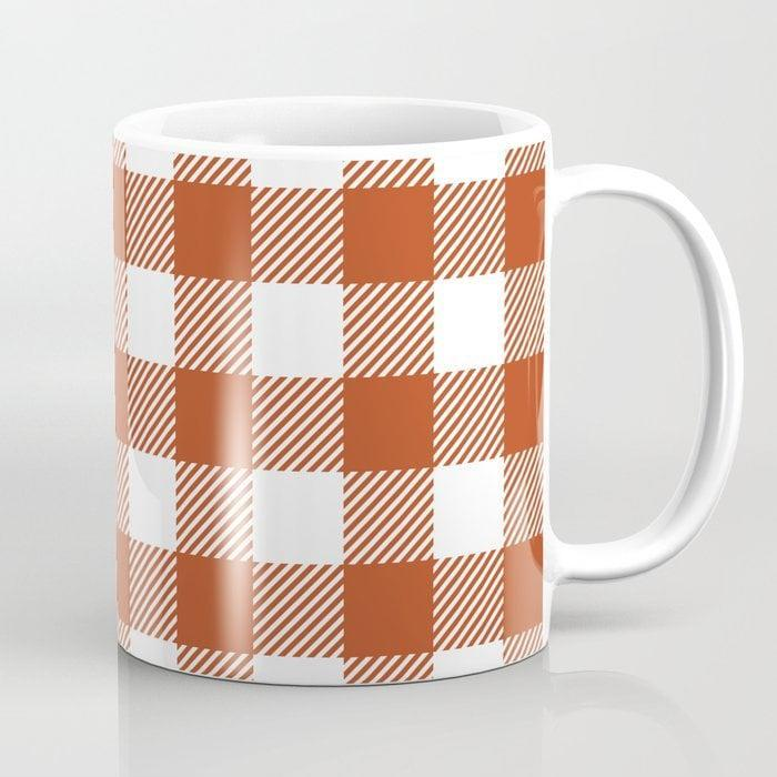 <p>This <span>Buffalo Plaid Dark Orange Coffee Mug</span> ($14, originally $17) is as fashionable as coffee mugs come. Why not pair it with a plaid button-down shirt for the ultimate matching look?</p>