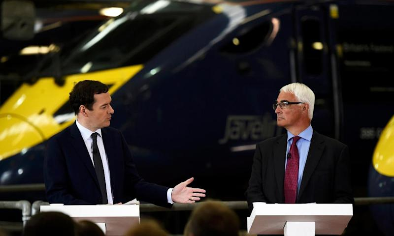 George Osborne and Alistair Darling standing at podiums at an event together