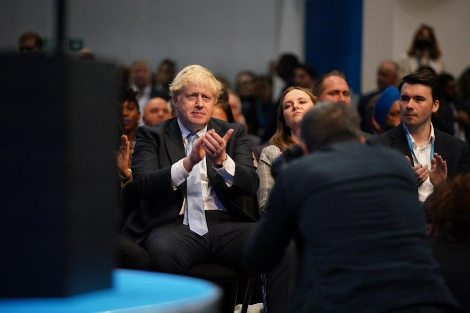 Prime Minister Boris Johnson applauds as Chancellor Rishi Sunak speaks at the Conservative Party conference in Manchester (Peter Byrne/PA) (PA Wire)