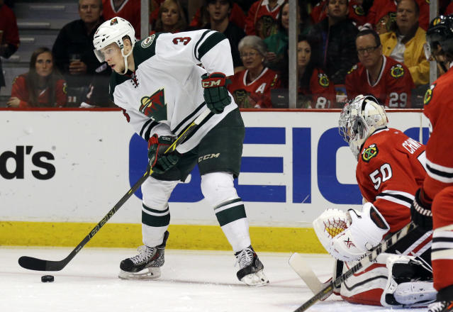 Minnesota Wild's Charlie Coyle (3) looks to a pass against the Chicago Blackhawks during the first period in Game 5 of an NHL hockey second-round playoff series in Chicago,Sunday, May 11, 2014. (AP Photo/Nam Y. Huh)