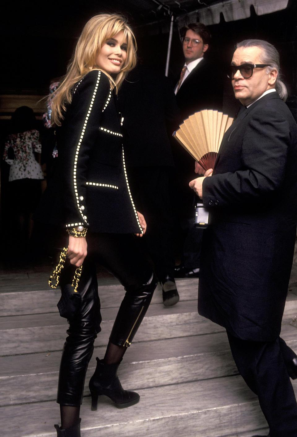 <p>Here, Karl Lagerfeld is pictured with model Claudia Schiffer at the Vogue magazine 100th anniversary party. In the same year, he was took the helm at Chloé before being replaced by Stella McCartney seven years later. <em>[Photo: Getty]</em> </p>