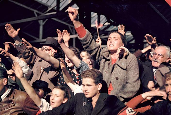 """Crowds cheering Adolf Hitler's campaign to unite Austria and Germany, 1938. (Hugo Jaeger—Time & Life Pictures/Getty Images) <br> <br> <a href=""""http://life.time.com/world-war-ii/nazi-propaganda-and-the-myth-of-aryan-invincibility/#1"""" rel=""""nofollow noopener"""" target=""""_blank"""" data-ylk=""""slk:Click here to see the full collection at LIFE.com"""" class=""""link rapid-noclick-resp"""">Click here to see the full collection at LIFE.com</a>"""
