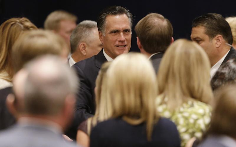 Republican presidential candidate and former Massachusetts Gov. Mitt Romney greets donors after he spoke at a campaign fundraising event in Atlanta, Wednesday, Sept. 19, 2012. (AP Photo/Charles Dharapak)