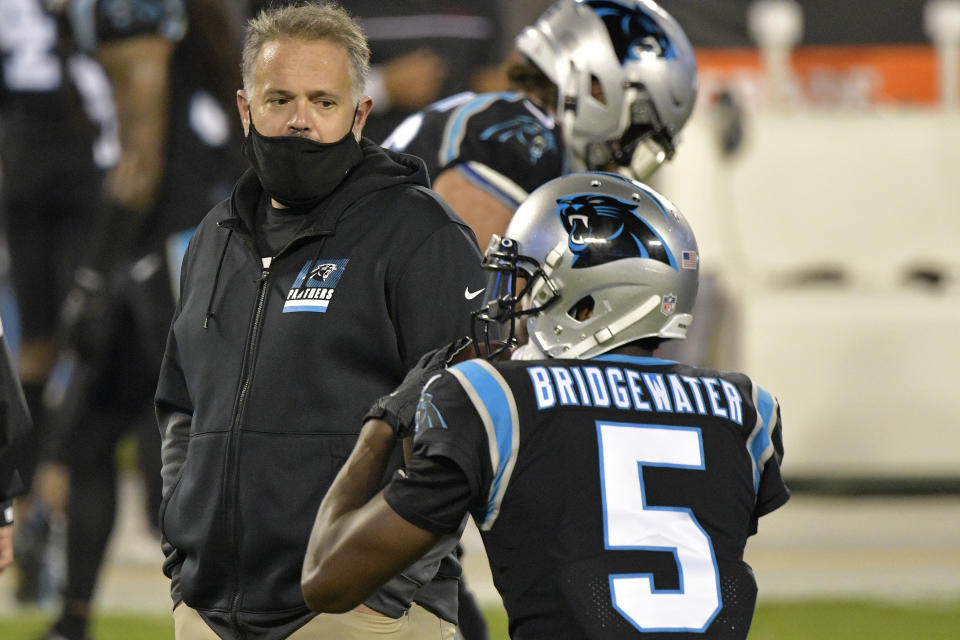 CHARLOTTE, NORTH CAROLINA - OCTOBER 29: Head coach Matt Rhule of the Carolina Panthers watches Teddy Bridgewater #5  during warm ups against the Atlanta Falcons at Bank of America Stadium on October 29, 2020 in Charlotte, North Carolina. (Photo by Grant Halverson/Getty Images)