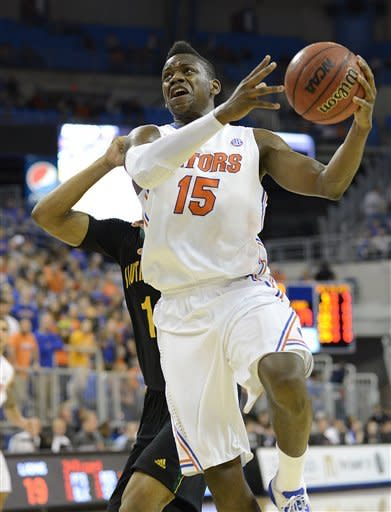 Florida Gators forward Will Yeguete (15) goes up for two points during the first half of an NCAA college basketball game against Southeastern Louisiana in Gainesville, Fla., Wednesday, Dec. 19, 2012. (AP Photo/Phil Sandlin)