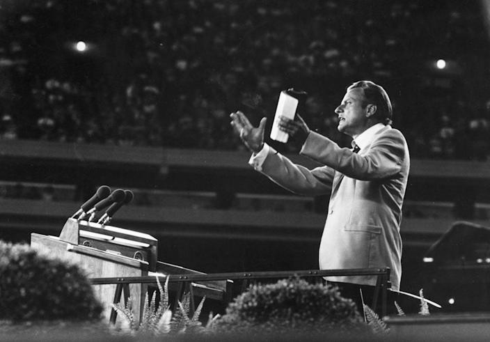 """<span class=""""caption"""">Evangelist Billy Graham came to have an enormous influence on American politics and culture.</span> <span class=""""attribution""""><a class=""""link rapid-noclick-resp"""" href=""""https://www.gettyimages.com/detail/news-photo/evangelist-billy-graham-addressing-a-meeting-news-photo/3317456?adppopup=true"""" rel=""""nofollow noopener"""" target=""""_blank"""" data-ylk=""""slk:Keystone/ Collections Hulton Archive/Getty Images"""">Keystone/ Collections Hulton Archive/Getty Images</a></span>"""