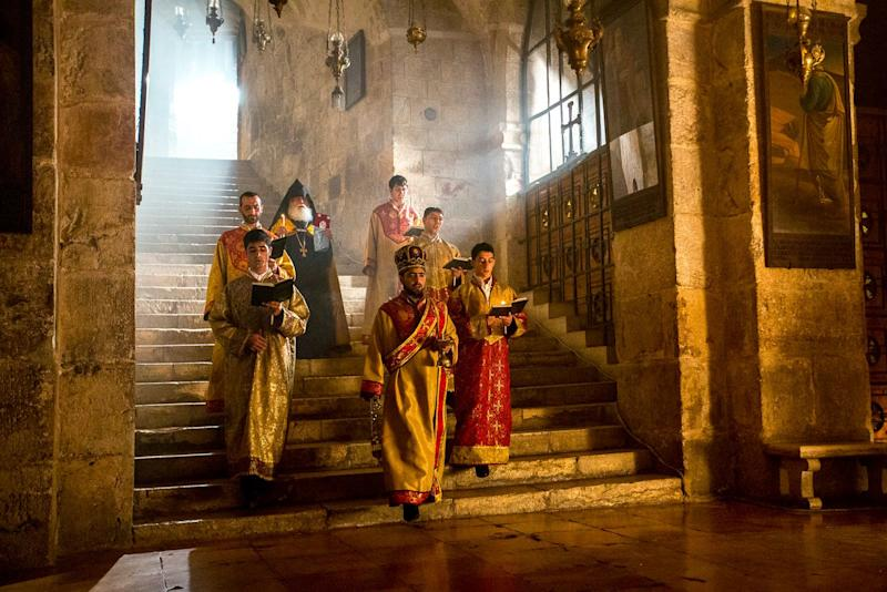 A group of Armenian Apostolic priests descends the stairs to the Chapel of St Helena in the Church of the Holy Sepulchre. Tradition holds that Helena, mother to the Emperor Constantine, discovered remnants of the True Cross here in the 4th century C.E. (AD) during the construction of the original church.